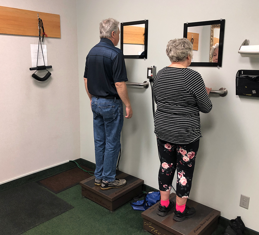 "Patients using the ""vibe plate"" after their session"
